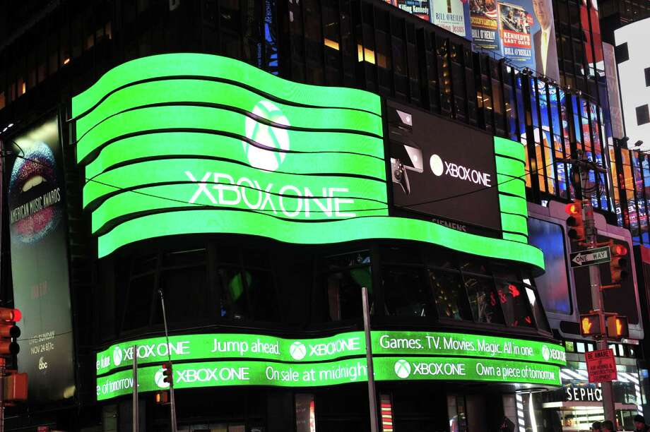 A giant video screen shows the logo for Microsoft's Xbox One game console Thursday in New York's Times Square. The Xbox One went on sale at 12:01 am EST Friday. Photo: STAN HONDA, Ap/getty / 2013 AFP