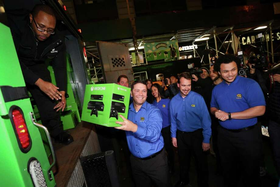 Best Buy Blue Shirts unload the highly anticipated Xbox One consoles from armored trucks during launch night at the Best Buy Theater, Thursday, in New York. Image distributed for Best Buy. Photo: John Minchillo, Ap/getty / AP
