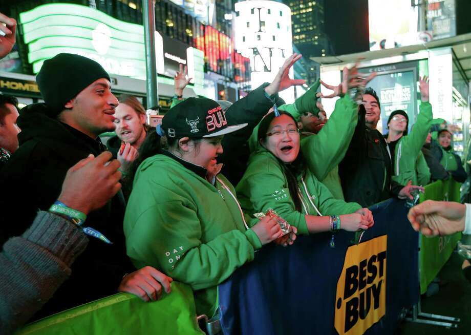People line up outside the Best Buy Theater in Times Square awaiting the opportunity to purchase Microsoft's Xbox One video gaming console at a midnight sales launch, in New York.  Photo: Kathy Willens, Ap/getty / AP