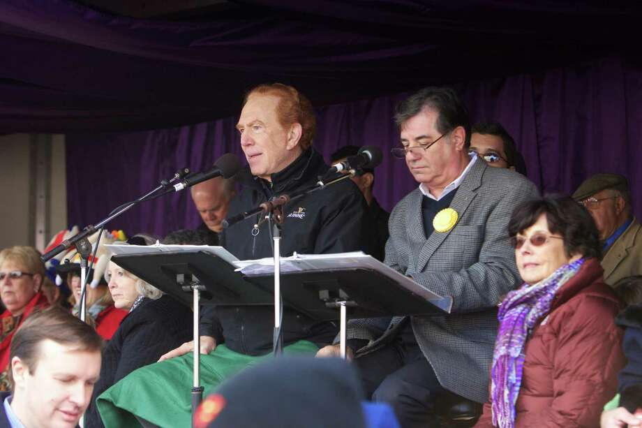 "Master of ceremonies, Alan Kalter, of ""Late Show with David Letterman,"" sits next to Stamford, Conn., Mayor Michael Pavia during the 2012 UBS Parade Spectacular. Kalter will return for the 2013 parade, marking his 10th year at the post. Photo: Contributed Photo / Stamford Advocate Contributed"