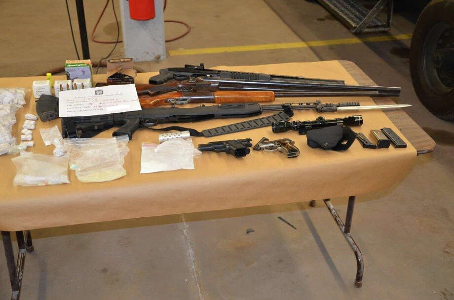 Drugs and guns seized in a raid on a Bridgeport apartment Photo: Contributed Photo / Connecticut Post Contributed