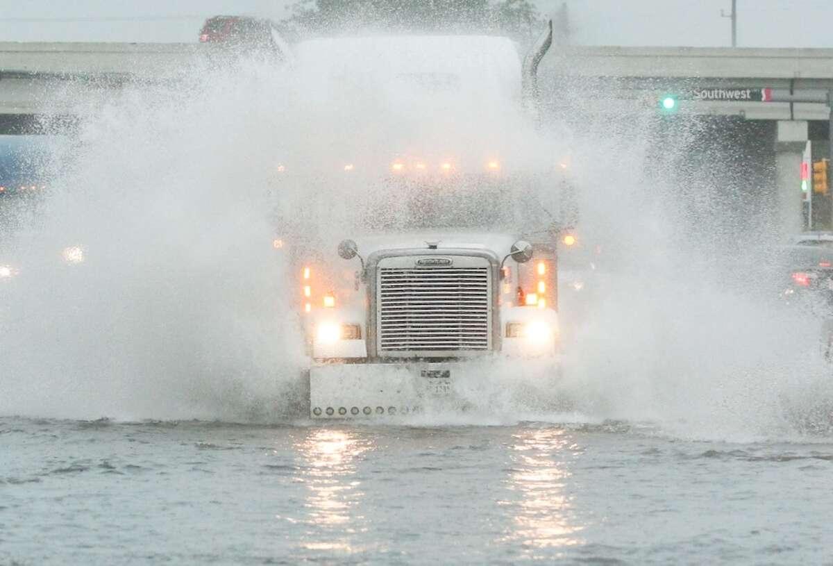 Cars drive through high water on Fondren Friday, Nov. 22, 2013.