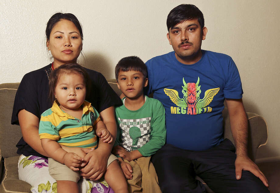 Durga Sapkota, with his wife, Tara Gurung, and sons Prayag Shapkota, 1, and Pratik Sapkota, 7, recently settled in San Antonio. Photo: Edward A. Ornelas / San Antonio Express-News