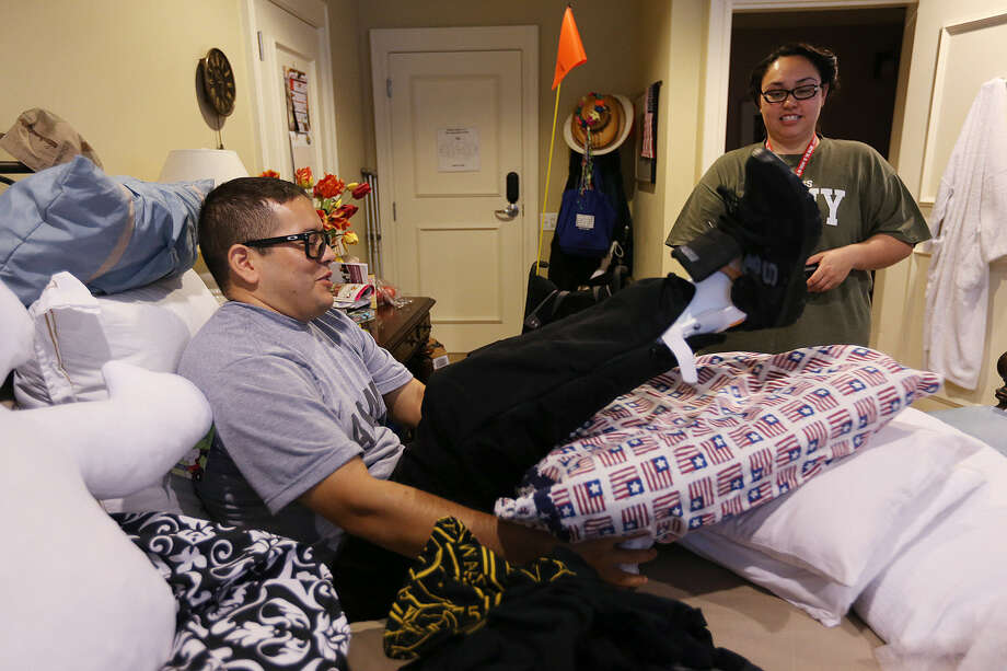Arizona National Guard Sgt. David Baldenegro and his wife, Valerie, reside in a Fisher House at Joint Base San Antonio-Fort Sam Houston. Baldenegro is  receiving rehab for  wounds suffered in a mortar attack while in Afghanistan more than a year ago. Photo: Jerry Lara / San Antonio Express-News