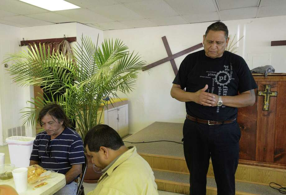 Sierra prays for the people who come to Sí Se Puede Ministries. He runs his ministry out of a storefront on Blanco Road.