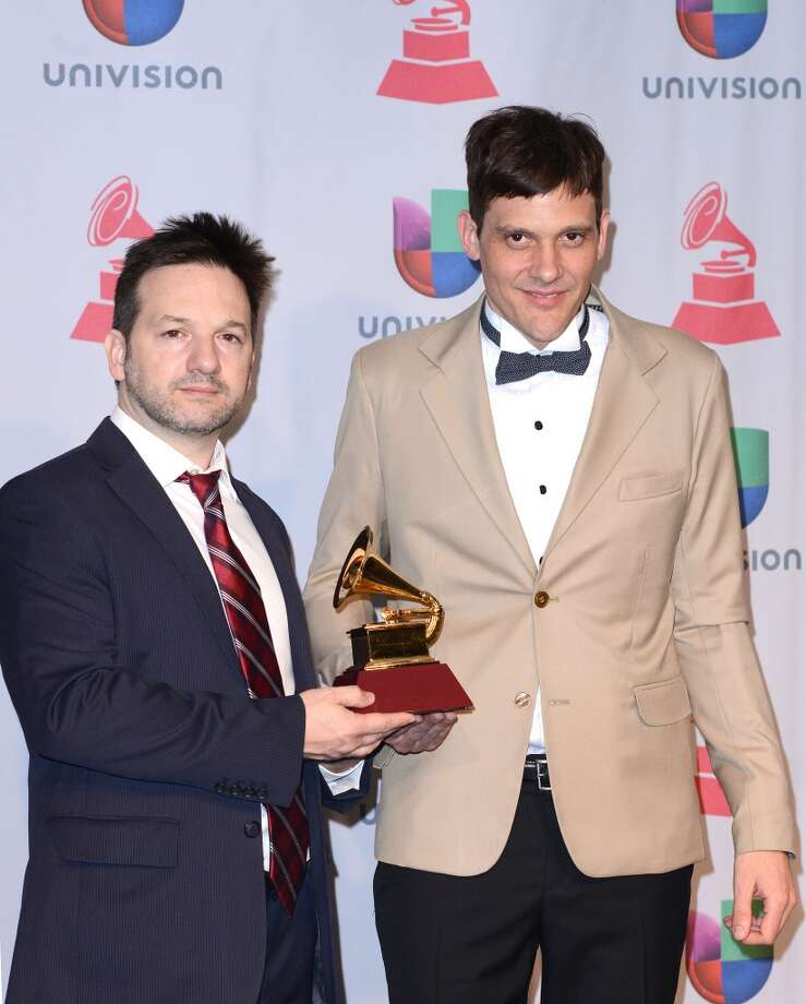 Juan Campodnico (R) of Bajofondo poses with Best Alternative Song award. Photo: C Flanigan, Getty Images