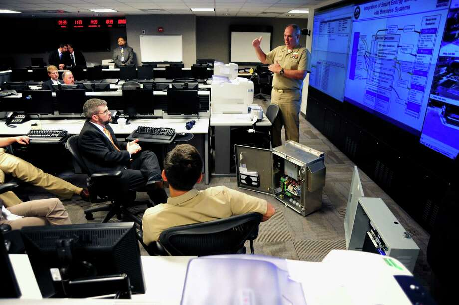 Naval District Washington officials make a presentation to John Conger, acting deputy undersecretary of defense for installations and environment (center) in 2011. A new round of base realignments and closures may be necessary. Photo: U.S. Navy / digital