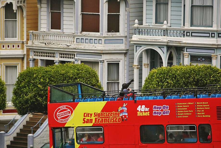 "A giant tour bus passes the ""painted ladies"" at Alamo Square - traffic also is a concern at the proposed waterfront arena. Photo: Raphael Kluzniok, The Chronicle"