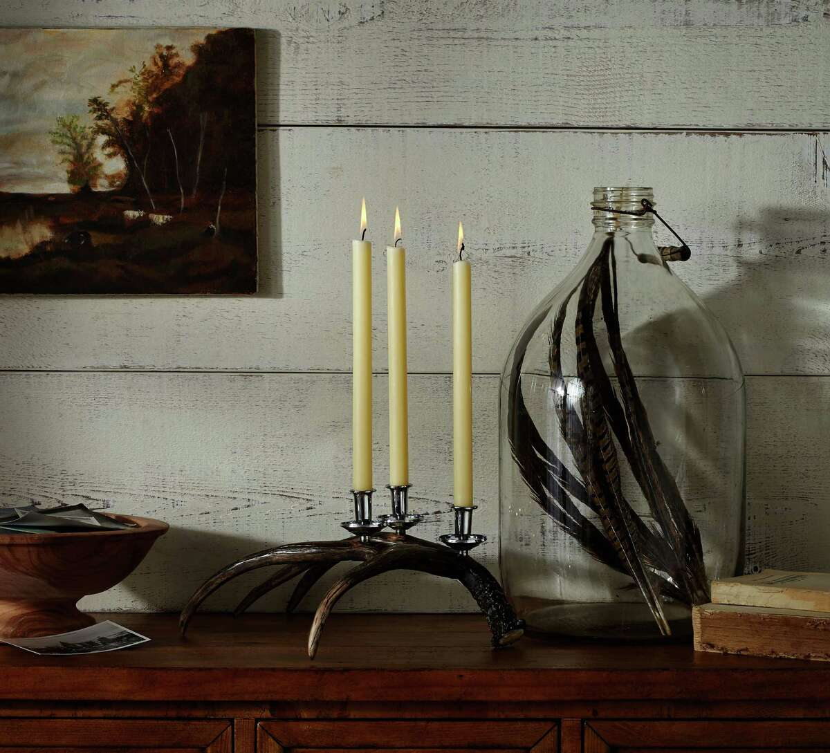 This photo provided by Pottery Barn shows a cast resin antler-shaped candelabra that adds rustic interest to the Thanksgiving table without the fussiness of polishing silver. Some expert advice and helpful products can make Thanksgiving entertaining more stylish, fun and fret-free. (AP Photo/Pottery Barn)