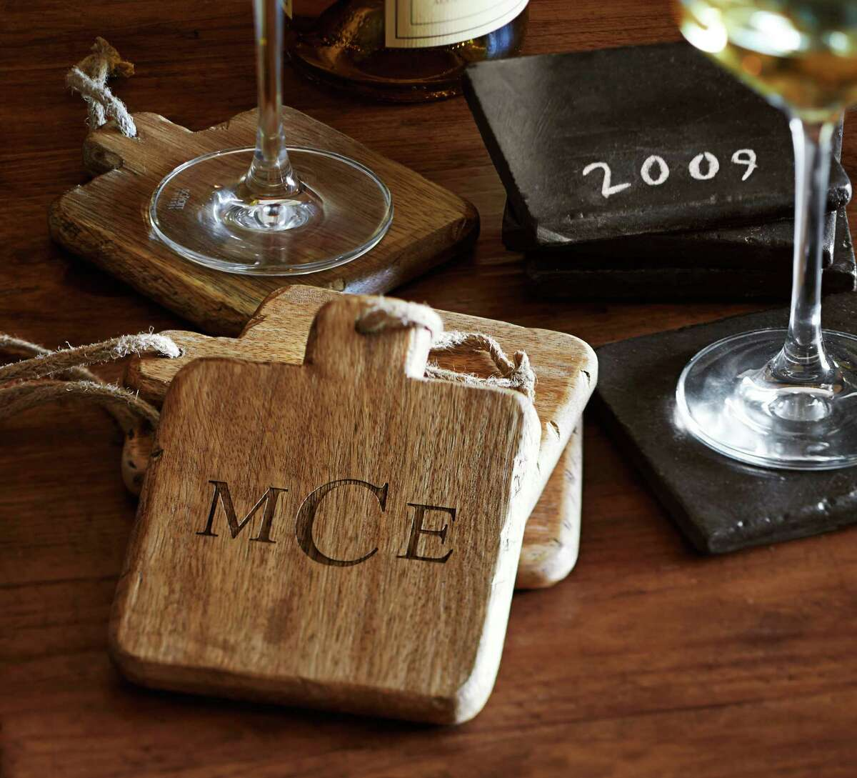 This photo provided by Pottery Barn shows wooden drink coasters that add a casual and appealing element of texture to entertaining accessories. Easier to clean than fabric coasters, they're also useful under warm serveware at the table. (AP Photo/Pottery Barn, Alec Hemer, Joseph Antonetti)