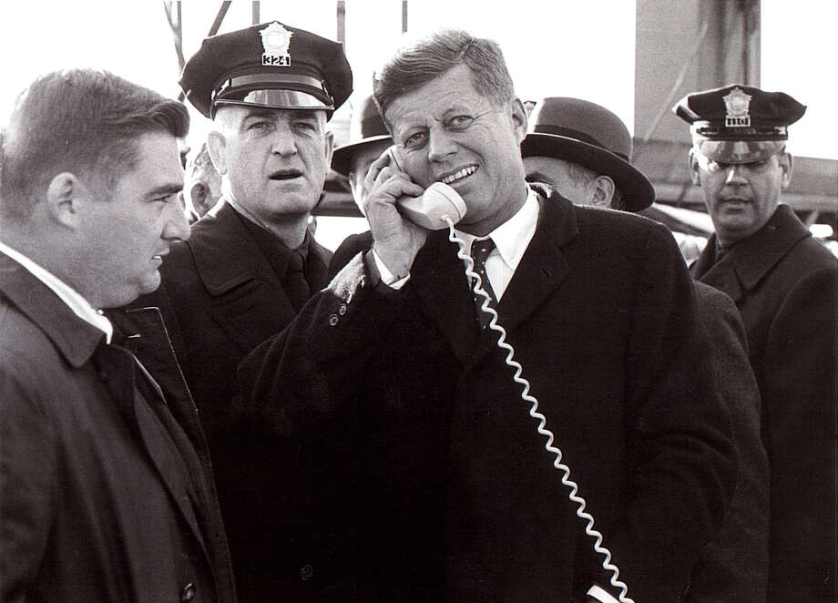 John F. Kennedy visited the Bridgeport area twice, first as a US Senator and Presdiential candidate in 1960, and as President in 1962. He is seen here with White House Press Secretary Pierre Salinger and Bridgeport Police Capt. Ray Tierney. Photo: Contributed Photo / Connecticut Post Contributed