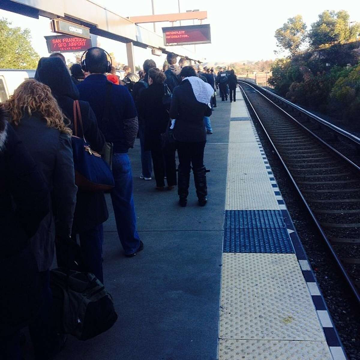 Passengers wait at the Concord BART platform for a train Friday morning. An hours-long computer problem knocked the system out of commission, with the first trains not running until 7:30 AM.
