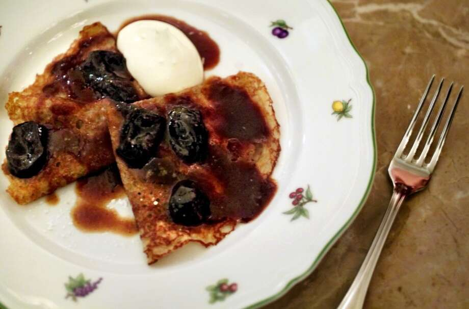 The warm buckwheat crepes with prunes and creme fraiche served at Quince, 2004 Photo: Carlos Avila Gonzalez, SFC