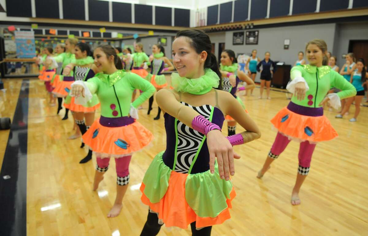 Tomball Memorial High Silver Stars drill team members Regina San Pietro, center, with Madison Mocek, left, and Ashlynne Boles, right, rehearse the dance they will perform in this year's Macy's Thanksgiving Day Parade.