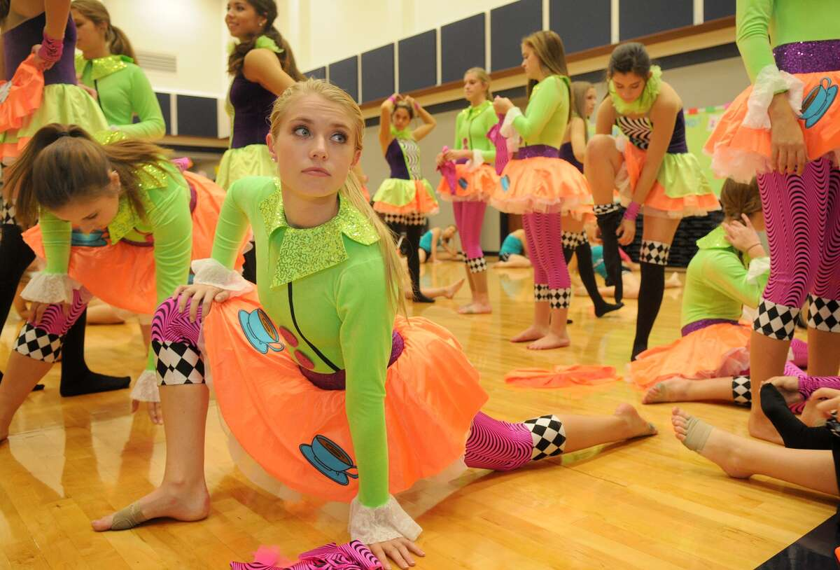 Maddie Gray, co-captain of the Tomball Memorial High School Silver Stars drill team, leads her squad in stretching before a rehearsal of the dance that they will perform at Thanksgiving.