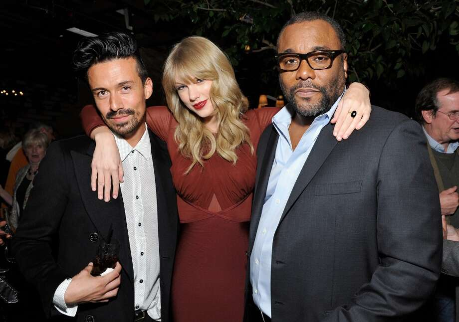 (L-R) Fisher Daniels, Taylor Swift and Lee Daniels attend the Weinstein Company's holiday party at RivaBella on November 21, 2013 in West Hollywood, California. Photo: John Sciulli, Getty Images For The Weinstein Company