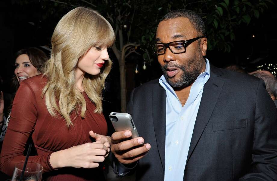 (L-R) Taylor Swift and Lee Daniels attend the Weinstein Company's holiday party at RivaBella on November 21, 2013 in West Hollywood, California. Photo: John Sciulli, Getty Images For The Weinstein Company