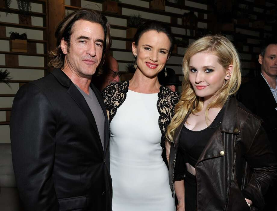 (L-R) Dermot Mulroney, Juliette Lewis and Abigail Breslin attend the Weinstein Company's holiday party at RivaBella on November 21, 2013 in West Hollywood, California. Photo: John Sciulli