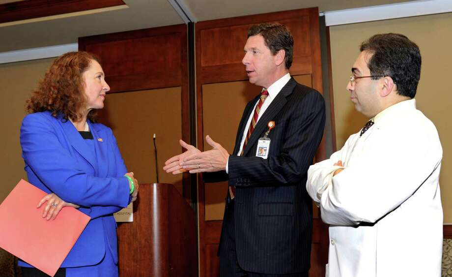 U.S. Rep. Elizabeth Esty, left, speaking with Dr. John Murphy, center and Dr. Ramin Ahmadi,  was at Danbury Hospital Friday, Nov. 22, 2013, for an announcement concerning expansion preventive medicine programs for the Western Connecticut Health Network. Murphy is president of the Western Connecticut Health Network and Ramin Ahmadi is director of medical education and research. Photo: Carol Kaliff / The News-Times