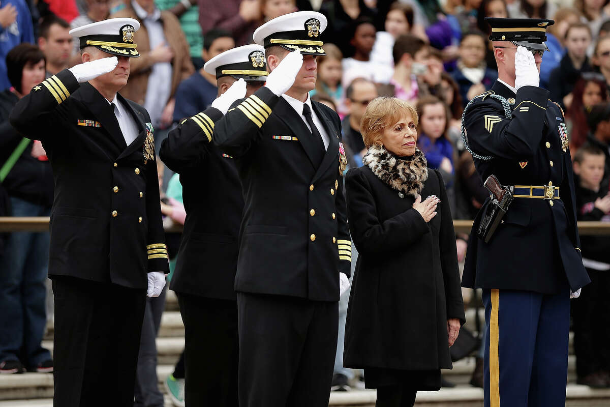 Accompanied by members of the U.S. Navy SEALs, Carmella LaSpada (2nd R), White House Special Projects Aide to President John F. Kennedy, participates in a wreath laying ceremony at the Tomb of the Unknowns in honor of Kennedy at Arlington National Cemetery November 22, 2013 in Arlington, Virginia. Remembrance ceremonies were held across the United States today, the 50th anniversary of the assassination of President Kennedy. President Kennedy established the Navy SEALs in 1962 as a small, elite maritime military force to conduct unconventional warfare.