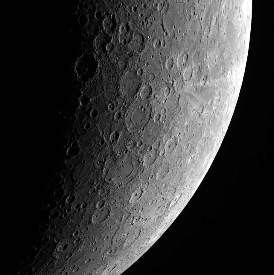 NASA - The heavily-cratered surface of Mercury appears like that of the Moon, although the Moon and Mercury have little geology in common. This photo was taken by NASAâÄôs Messenger spacecraft on April 23, 2013. Photo: Contributed Photo / Connecticut Post Contributed