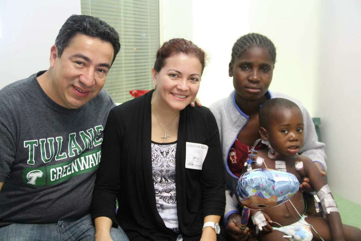 Luis and Maria Esther Olano, from left, are hosting 4-year-old Collings and his mother Jeneti from Lilongwe, Malawi, after the toddler underwent heart surgery in Houston.