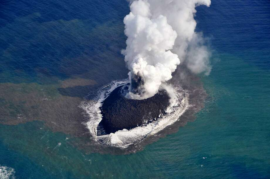 Birth of an island: Smoke rises from an islet created by a volcano near Japan's Ogasawara island chain. The little land mass is about 200 meters in diameter. Photo: Japan Coast Guard, AFP/Getty Images