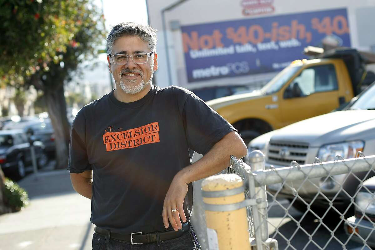 Supervisor John Avalos poses for a portrait on Mission St. as he talks about changes and concerns in his district, especially the proliferation of online gambling store fronts, during a walk in the Excelsior District in San Francisco, CA Thursday, October 31, 2013.