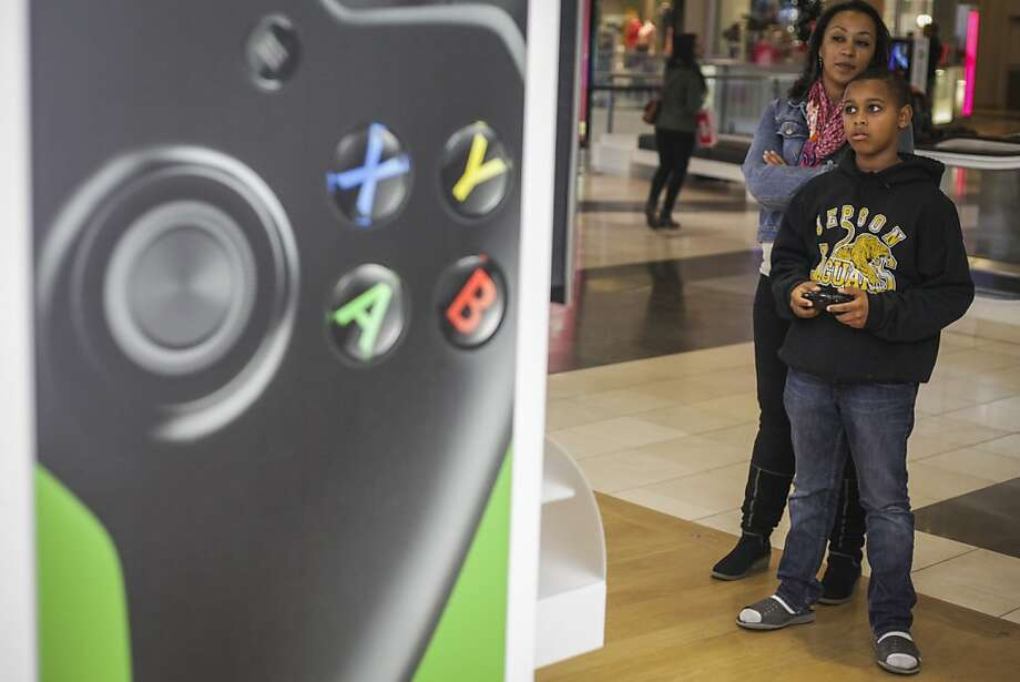 Jalen Ware plays the new Xbox One while Amber Whaley watches at Westfield San Francisco Centre. Photo: Sam Wolson, Special To The Chronicle