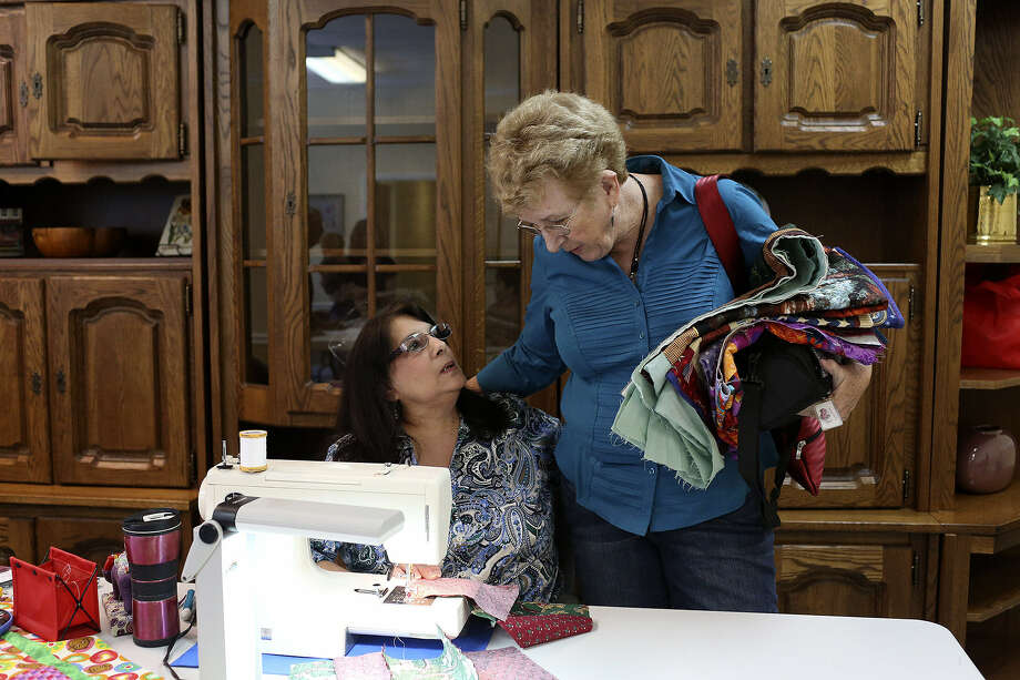 "Barbara Lucas (right), chapter Leader with San Antonio Military Quilts for Kids, talks with quilter Cindy Urbanek. Lucas says the term ""kid"" is broad: ""If you're a mother at the Warrior and Family Support Center, and your child in there is 20 years old, that's a kid."" Photo: Lisa Krantz / San Antonio Express-News"