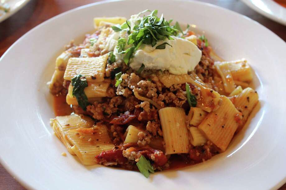 Rigatoni with fennel sausage, oven-roasted tomatoes, garlic, basil and goat cheese is served at Piatti at Éilan.  Photo: Jennifer McInnis