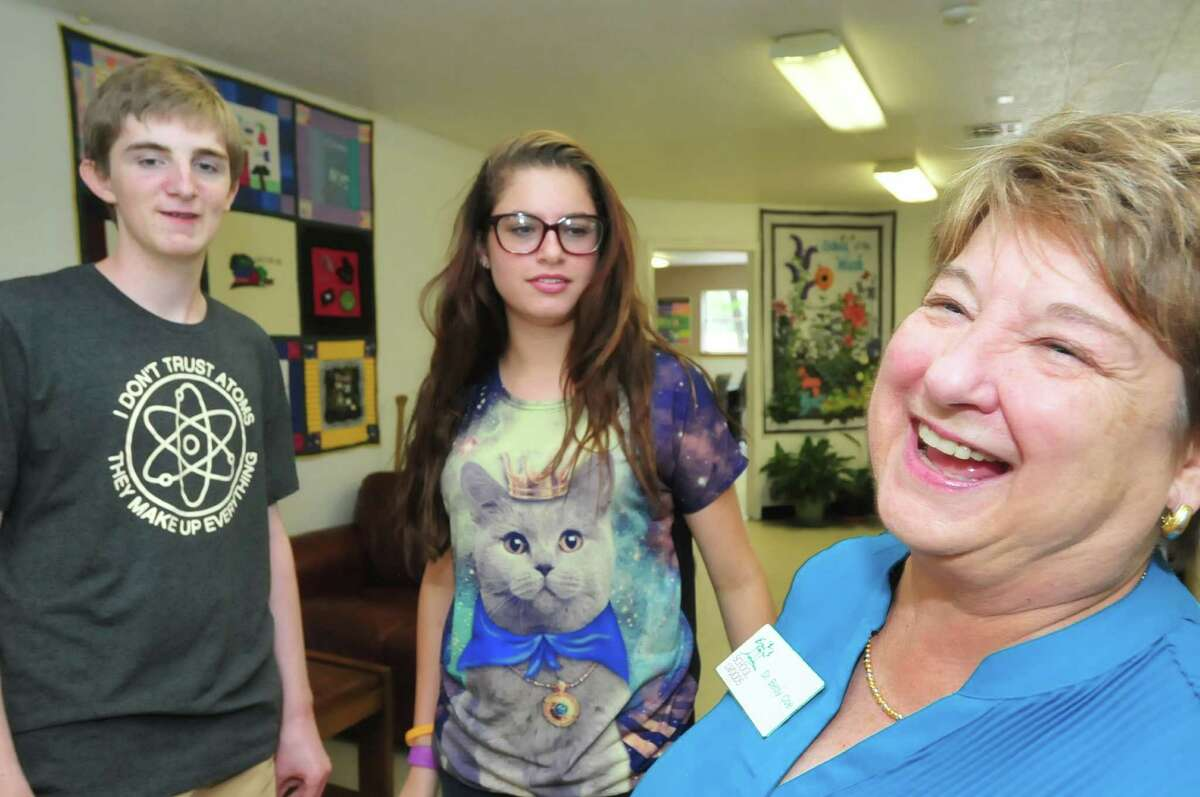 School of the Woods Principal Betsy Coe shares advice and a smile with students Riley McGuire, 16, and Camille Simmons, 15, during a break. The Montessori school dates to 1962, founded by area parents guided by educators Ernest and Hilda Wood.