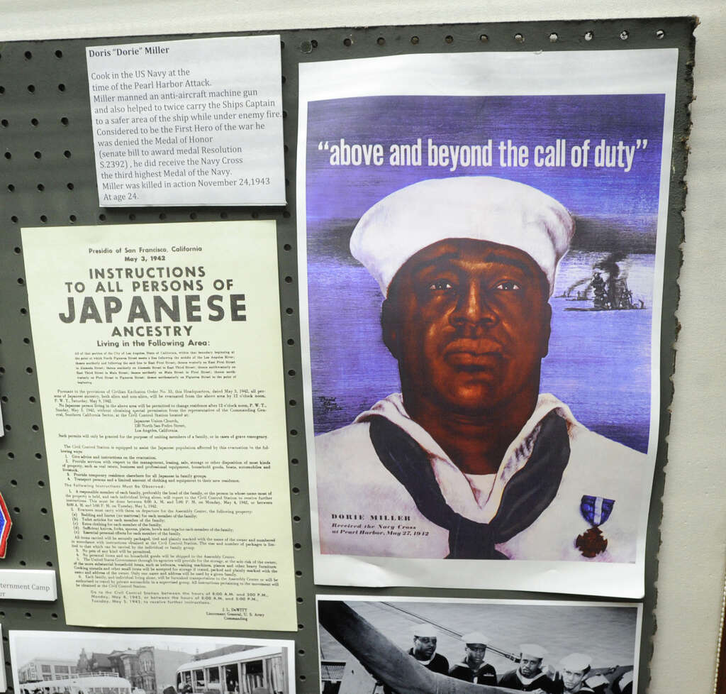 display takes sobering look at world war ii greenwichtime a poster of dorie miller of the u s navy who received the navy cross for his