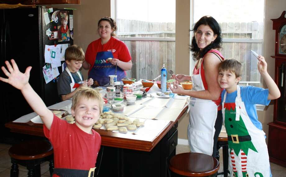 When I was a kid, my mother always gathered my sister, me, and our friends together for a long day of baking and decorating Christmas cookies. I continued that tradition with my daughters, my sons, and my husband. This is one of our more recent decorating parties--2011. My husband does all of the mixing, rolling, and cookie-cutting. The kids and I do the decorating, and then even though we are all exhausted, everyone pitches in to clean up the mess.
