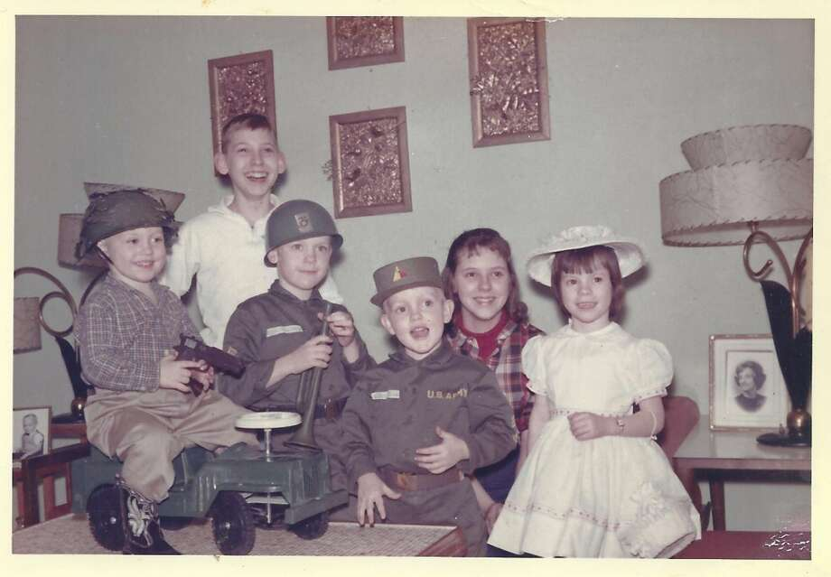 This photo was taken in 1965 and our oldest brother was in the US Army. He wasn't home for the holiday but he wasn't forgotten in our home. My younger brothers dressed up in their army outfits to make us feel he was near.
