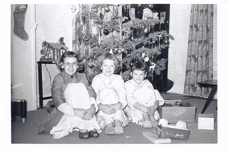 The happiness in this Christmas Eve photo reflected our joy at receiving Christmas slippers and our Christmas night robes. Three sisters in 1955 with our home spun decorated tree.