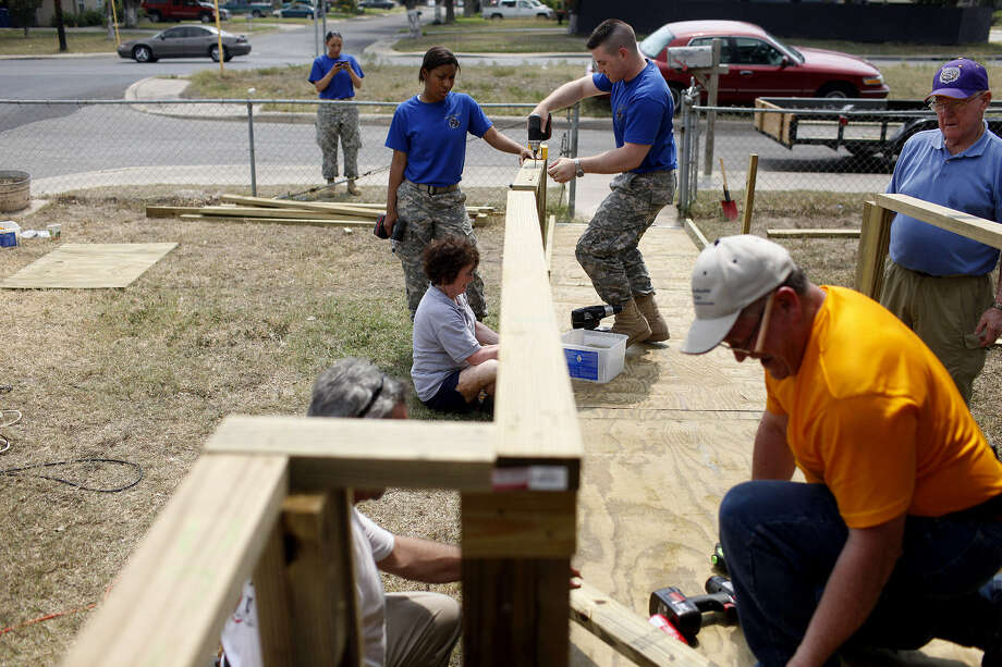 Volunteers build a ramp for a San Antonio resident. The project receives thousands of requests a year. Photo: Lisa Krantz / San Antonio Express-News