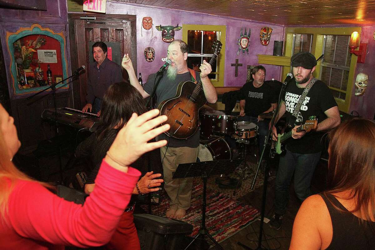 Shinyribs singer Kevin Russell has the dancers moving on a recent Wednesday night at Under the Volcano. The rhythm section is Keith Langford on drums and Jeff Brown on bass.