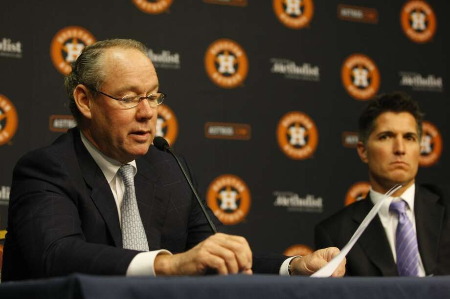 Jim Crane answers questions next to Astros council Giles Kibbe during a press conference at Minute Maid Park about the lawsuit Crane filed against former Astros owner Drayton McLane. Photo: Johnny Hanson, Houston Chronicle