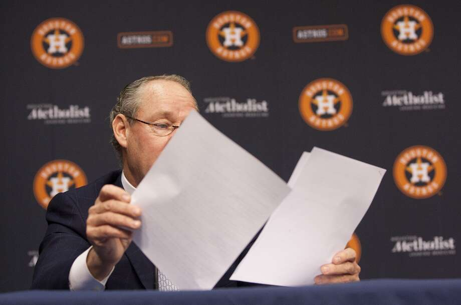 Astros owner Jim Crane reads a prepared statement. Photo: Johnny Hanson, Houston Chronicle