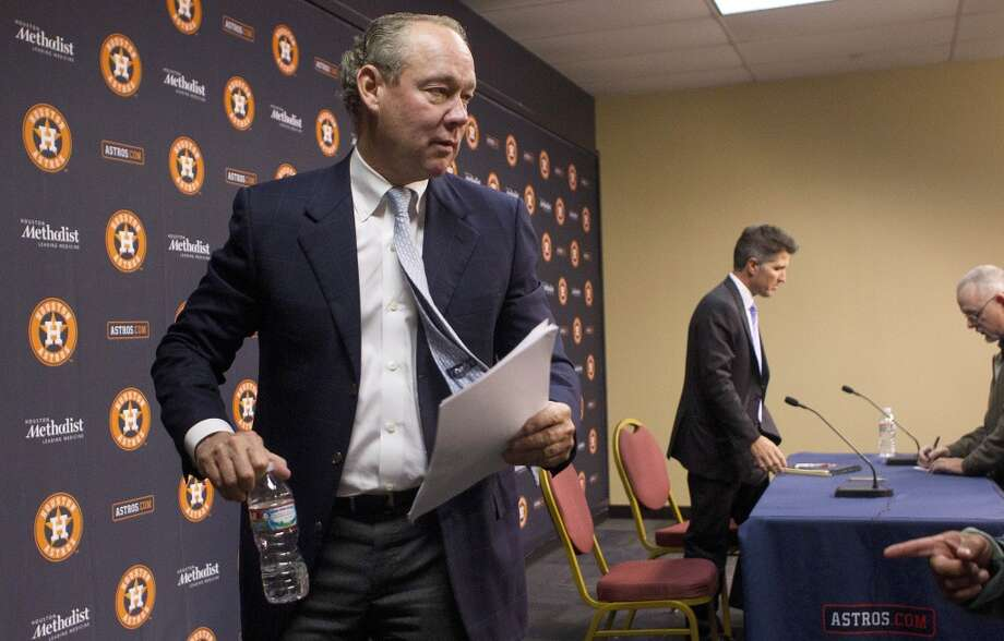 Astros owner Jim Crane exits the press conference. Photo: Johnny Hanson, Houston Chronicle