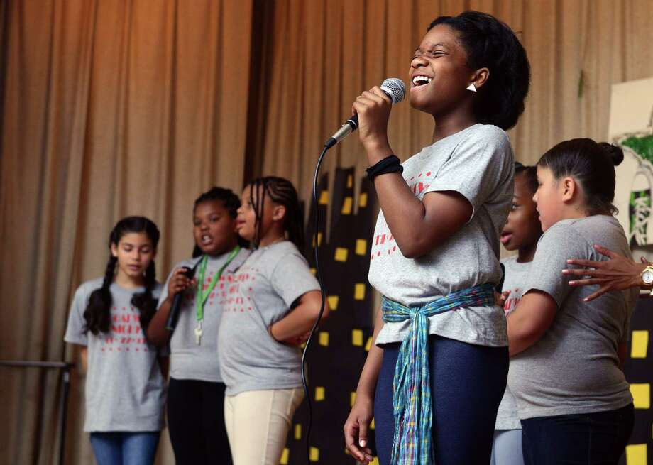 "Fifth grade student Imani Tyson sings ""How Will I Know"" as Hall School celebrates 100 years with a broadway review performed by students Friday, Nov. 22, 2013 at the school in Bridgeport, Conn. Photo: Autumn Driscoll / Connecticut Post"
