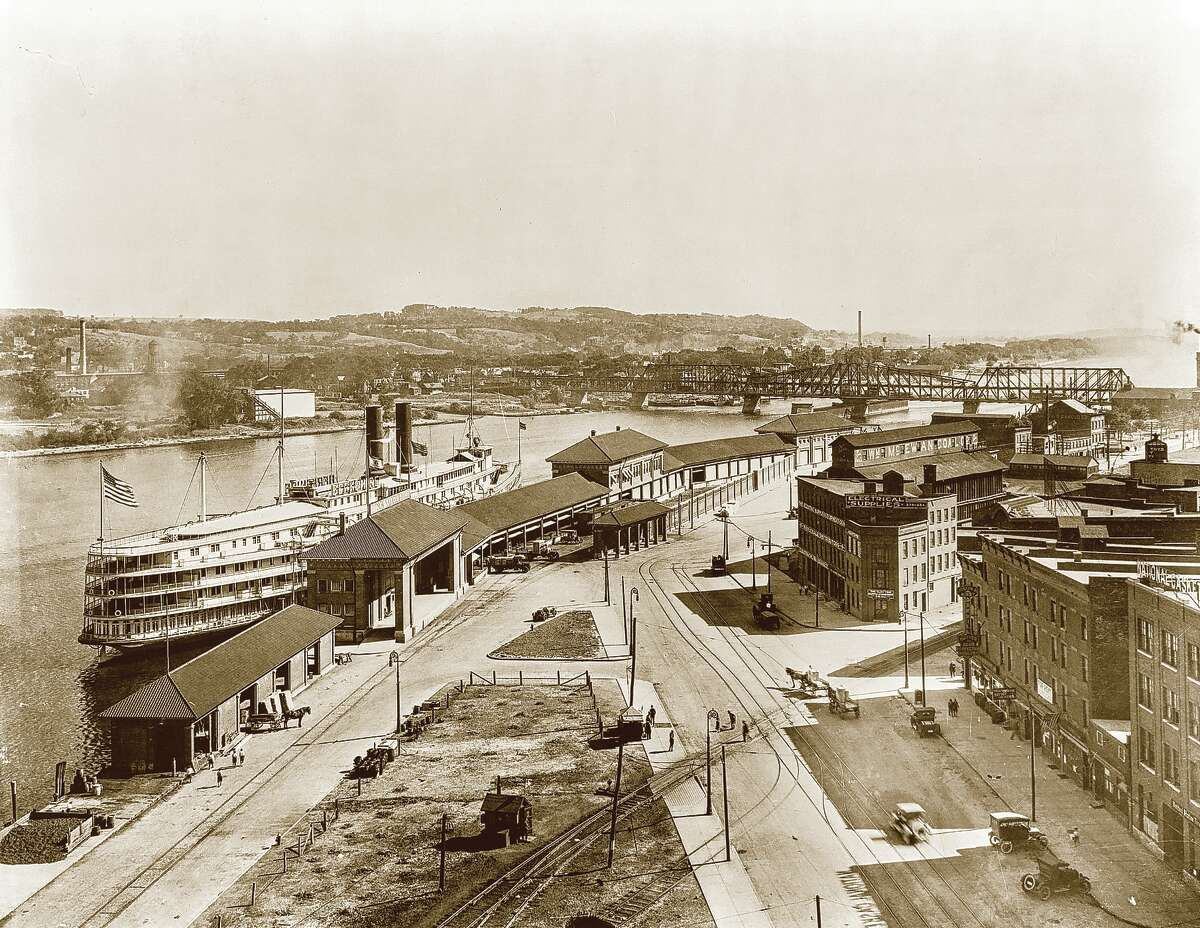 (Library of Congress) Bird?s-eye view of Albany?s wharf area, showing a night boat landing, with the Livingson Avenue Bridge in background.