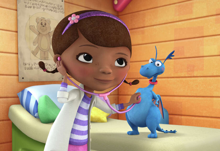 """In this image released by Disney Junior, the character Doc McStuffins is shown with Stuff in a scene from Disney Junior's animated series """"Doc McStuffins."""" The show, about a six-year-old girl who runs and operates a clinic for broken toys and worn out stuffed animals out of the playhouse in her backyard, will debut Friday, March 23, on the new 24-hour Disney Junior channel. (AP Photo/Disney Junior) Photo: Disney Junior, HONS / Associated Press / © 2011 Disney Enterprises, Inc.  All rights reserved."""