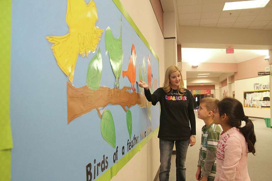 North Pointe Elementary counselor Jennifer McCaffrey explains artwork and vocabulary on walls that reinforce good character to second-graders Jack Hammock and Misbah Aziz. The campus is named a National School of Character.North Pointe Elementary counselor Jennifer McCaffrey explains artwork and vocabulary on walls that reinforce good character to second-graders Jack Hammock and Misbah Aziz. The campus is named a National School of Character. Photo: Pin Lim, Freelance / Copyright Pin Lim.