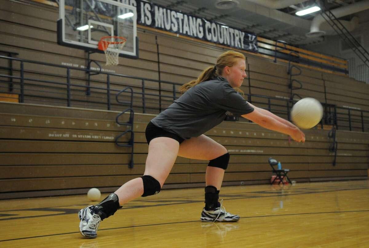 Kingwood senior setter Devyn Johnson works on her passing technique during a team practice.
