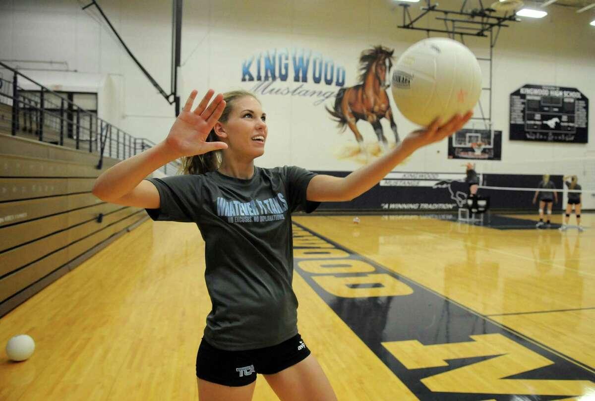 Kingwood senior middle blocker Tory Salness works on her serve during a team practice.