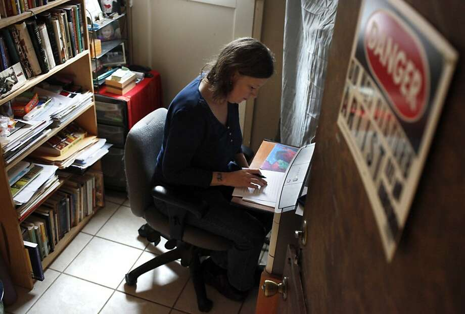 Caroline Goodwin of Montara searches for inspiration in her office between the washer-dryer and the water heater. Photo: Lacy Atkins, The Chronicle