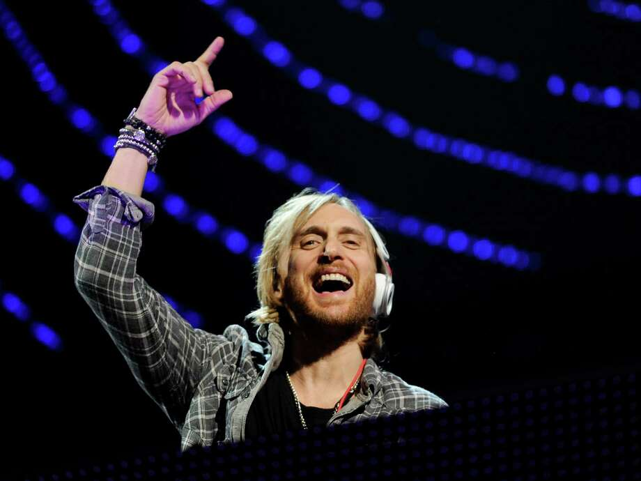"FILE - In this Dec. 9, 2011 file photo, DJ David Guetta performs at Z100's Jingle Ball concert at Madison Square Garden in New York.  Guetta can't wait for you to hear his new song ""One Voice""  for a couple of reasons. The song is at the heart of a new partnership with the United Nations and the 46-year-old French producer and DJ hopes it will inspire fans to donate money for humanitarian relief around the world, simply by tweeting. And he wants you to hear a brand new side of his musical personality.(AP Photo/Evan Agostini, file) ORG XMIT: NY110 Photo: Evan Agostini / AGOEV"