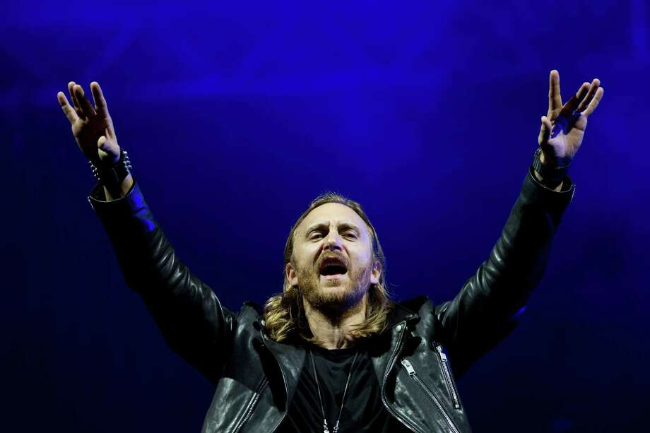 "FILE - This Sept. 13, 2013 file photo shows French recording artist David Guetta performing at the opening night of the 5th annual Rock in Rio music festival, in Rio de Janeiro, Brazil. Guetta will project a full-length music video for his new track ""One Voice"" onto the exterior of the United Nations Secretariat Building, Friday, Nov. 22, to launch  ""The World Needs More"" campaign.   (AP Photo/Felipe Dana, File) ORG XMIT: NYET482 Photo: Felipe Dana / AP"